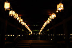 Night scene of votive lanterns at Japanese temple. Votive paper lanterns for ancestor's spirits on the day of Obon of Japan, traditional customs of Japanese life royalty free stock photos