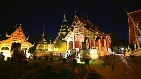 Night scene Wat Phra Singh timelapse, Chiang mai, Thailand. Beautiful Wat Phra Singh temple the very most famous temple at twilight, Chiang Mai, Thailand stock footage