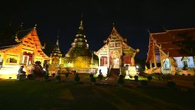Night scene Wat Phra Singh timelapse, Chiang mai, Thailand. Beautiful Wat Phra Singh temple the very most famous temple at twilight, Chiang Mai, Thailand stock video footage