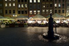 Night scene with a water tap at the Old Town Market Place royalty free stock photos