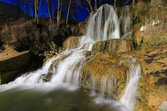 Night scene with waterfall Stock Photos