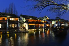 The night scene of Wuzhen town in Zhejiang, China. Wuzhen, a 1300-year-old water town on the lower reaches of the Yangtze River, is a national 5A scenic area and stock photos