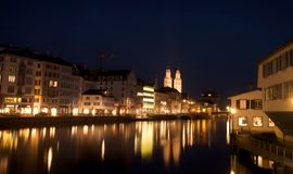 Night scene of Zurich river, in front of Zurich central station Royalty Free Stock Images