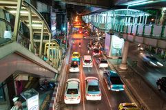 Night scenery with heavy traffic near a Skytrain station in Bangkok, Thailand on May 22, 2014 Stock Photography
