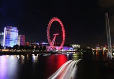 Night scenery of London Eye - a giant ferris wheel on the South Bank of the river Thames London United Kingdom. The tallest ferris wheel in Europe and one of stock photos