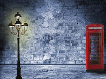 Night scenery in the London street. Vintage scenery, brick wall, lantern and phone box, night scenery in the street Stock Photo