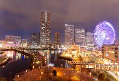 Night scenery of Minatomirai Bay Area in Yokohama City, with Landmark Tower among high rise skyscrapers. A giant Ferris wheel in an Amusement Park & beautiful stock images
