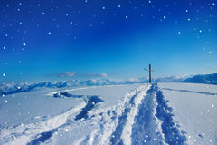 Night scenery at mountain peak with snowflakes Royalty Free Stock Image