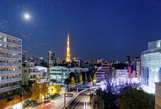 Night scenery of romantic Winter Illumination Display at Christmas, in Roppongi Hills. Tokyo, Japan, with the landmark Tokyo Tower under a full moon and royalty free stock photos