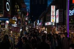 Night Scenery of Takeshita Street. Scenery of Takeshita Street near Harajuku station, Tokyo Prefecture, Japan. People walk around shops while shopping. This royalty free stock images
