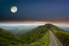 Night scenes of Green road with blue sky Royalty Free Stock Photography
