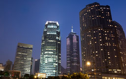 Night scenes of skyscrapers with blue sky royalty free stock images