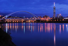 Night scenes of the Taipei city. With the bridge and beautiful reflection Stock Photos