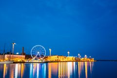 Night Scenic View Of Embankment With Ferris Wheel Royalty Free Stock Photo