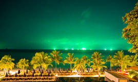 Night sea with green sky Stock Photography