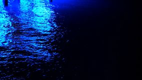 Night, sea. The water reflects the light, the moonlit path. close up. stock video