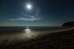 Night seascape on the beach with moonlight Stock Photos