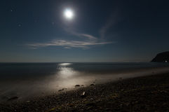 Night seascape on the beach with moonlight Stock Photo