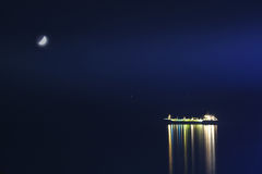 Night seascape. Night landscape with cargo ship and moon Royalty Free Stock Photo