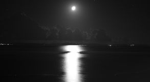 Night Seascape with Moon and Cloudy Sky Stock Image