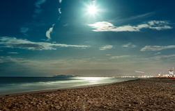 Night seascape on sand beach and full moon Royalty Free Stock Photo