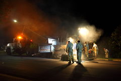 Night shift roadworks. With workmen asphalting the street of a residential area in Sydney, Australia Royalty Free Stock Image