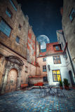 Night shining moon and stars. Vintage retro travel image of a narrow medieval street in old town Riga. night shining moon and stars Stock Photo