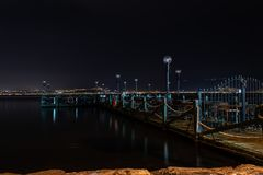 Night shoot from a cute pier with chairs and tables royalty free stock photos