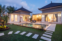 Night shoot Luxury and Private villa with pool outdoor. Exterior luxury villa in Bali with a garden, gazebo and swimming pool outdoors shoot at night time royalty free stock photos