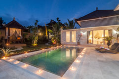 Night shoot Luxury and Private villa with pool outdoor. Exterior luxury villa in Bali with a garden, gazebo and swimming pool outdoors shoot at night time Stock Images