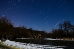 Night shooting stars. The photograph was taken in the cold, winter night, by moonlight. Long exposure allowed the star to draw lines Stock Photos