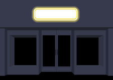 Night shop. Convenience store. Storefront at night. Empty black. Counters. Shining sign on facade of store Stock Images
