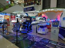 Shenzhen, China: aerospace science and technology experience activities, model space equipment. At night, shopping center, aerospace science and technology stock image