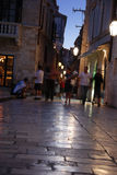 Night shopping in Dubrovnik, Croatia - blurred. Night shopping in Dubrovnik, Croatia -- people are blurred in motion stock images