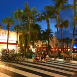 Night shopping on Lincoln Road Mall in Miami Beach. Shoppers of high end and luxury items make their way to the open air retail district Royalty Free Stock Photos