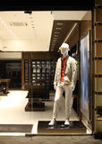 Night shopwindow with men dressed mannequins Stock Photo