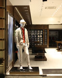 Night shopwindow with men dressed mannequins Stock Images