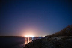 Night shore and barge lights Royalty Free Stock Image