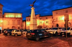 Medieval village of Mogliano in central Italy. Night shot of the ancient theater of Apollo and Piazza Garibaldi in the medieval town of Mogliano. Marche region royalty free stock photo