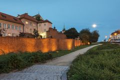 Night shot of the ancient walls in Warsaw Stock Photo