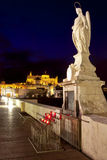 Night shot of Archangel Raphael statue on roman bridge at Cordoba, Andalusia Stock Images