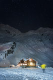 Night shot of balea lake cabin Stock Image