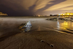 Night shot of the beach in Castro Urdiales Stock Images
