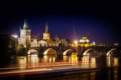 Night shot of Charles Bridge and river in Prague Stock Photography