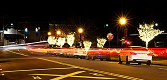 A night shot of Christmas lights and blurred car lights. stock photography
