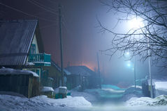 Night shot of country street under snow in winter season. Novosibirsk, Siberia, Russia Stock Images