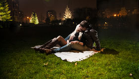 Night shot of couple in lying on grass Royalty Free Stock Photo