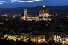 Night shot of Florence, Italy. Illuminated Florence Cathedral in skyline at night with blue skies Royalty Free Stock Photo