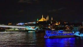 Night shot of Golden Horn Metro Bridge or Halic Bridge overlapping Suleymaniye Mosque, Istanbul, Turkey Royalty Free Stock Photography