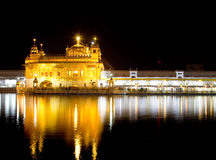 A night shot of the Golden Temple Harmandir Sahib in Amritsar, Punjab India. A night shot of the Golden Temple in Amritsar, Punjab India with reflection in the Stock Photography